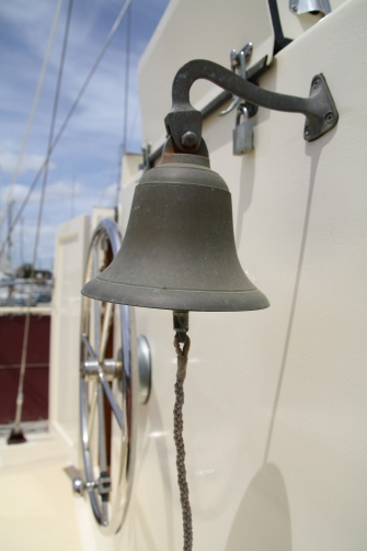 Ship's bell and steering wheel