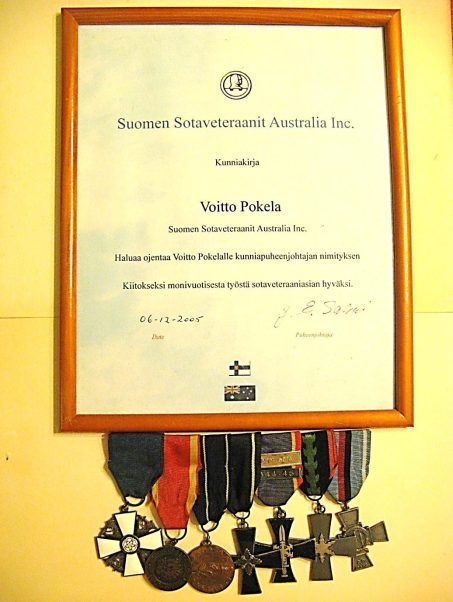 The Finnish War Veteran's Assoc of Australia recognised Dad's many years of service to the war veterans of Australia by naming him Honorary Chairperson. The Medal on the far left is a civilian one, **The Order of the White Rose, awarded to him by the Finnish government for his services to Australian Finns.